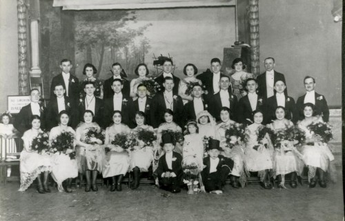 When Rose Friedman married Sam Buckman at Lehmann's Hall in 1920, the wedding party included 15 ushers, 14 bridesmaids (in a variety of fabrics and dress styles), 2 junior ushers, and 2 flower girls. Gift of Fran Gimbel. JMM 2007.18.1