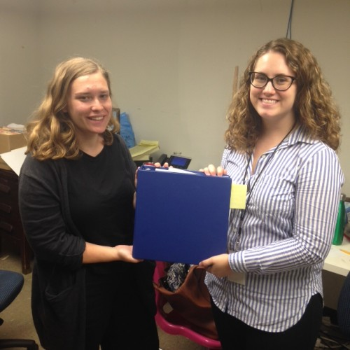 Joelle and Amy with the all-powerful traveling exhibit binder!