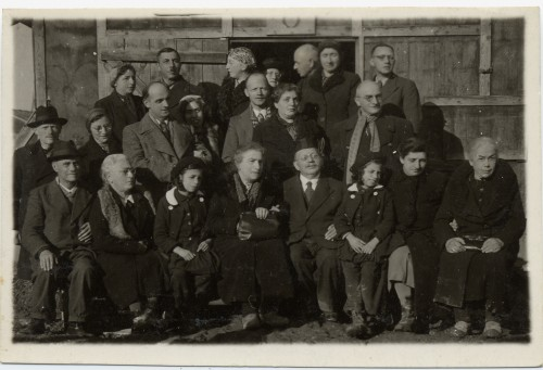 Members of the extended Weil and Wachenheimer families seated outside a barracks at Gurs, an internment camp in the French Pyrenees, 1940. Hilda and Theo Weil are standing in the second row on the right and Lina Wachenheimer is seated, front right. Courtesy of Brenda Mandel, L2002.103.1215.