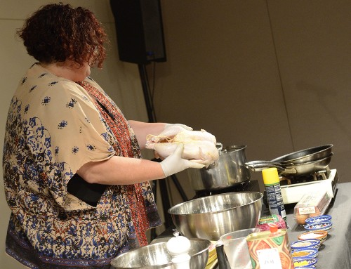 Vered shows off the ideal chicken at the Feast of Flavors cooking demo.