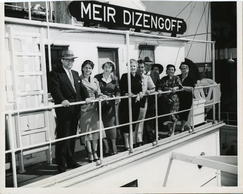 This publicity photo from 1951 features members of the Women's Division meeting Israel's Minister of Health, Dr. Joseph Burg. Dr. Burg was visiting Baltimore to help promote Israel Bonds. Also pictured are Captain Smolensk, captain of the Meir Dizengoff and Harry Diamond, Maryland's Israel Bond Director. JMM 1989.80.21