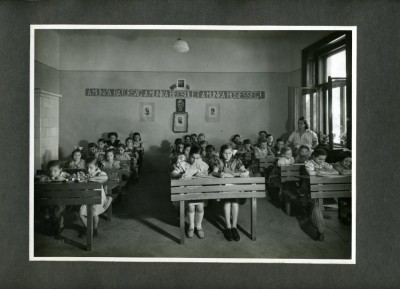 """Photo from album presented to Joseph Schwartz """"As a token of it's gratitude the Girl's Orphanage of the Jewish Women's Association, Budapest to Dr. J. Schwarz [sic] Chairman of the European Section of the A.J.D.C."""", n.d."""