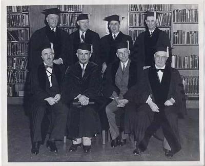 Dr. Joseph Schwartz, back right, and other men in academic regalia, n.d.