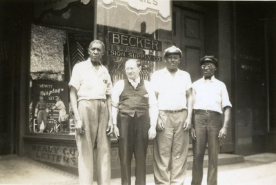 Herman Becker (second from left) with three unidentified employees of the Becker Sign Company, Baltimore, circa 1928.  Gift of the estate of Herschel Elliot Becker. JMM 1989.102.10