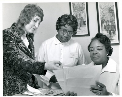 Jewish Family and Children's Services employees, 1971.  Though this photo is not annotated, it contains an even better clue: the woman in the center is wearing a name tag. She's Mrs. Ida Louise Carr, Homemaker and Home Health Aide for JFCS.  (The other two women are still unidentified.) Gift of The Associated. JMM 1997.134.147