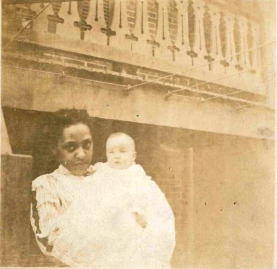 """The back of this photo is identified only with the date, """"June 1907.""""  Comparison with the rest of the family's collection tells us that the infant is Klare Lobe, but the African American woman holding her is unidentified.  A little digging in the records shows that in 1910, when the census was taken, the Lobes were boarding with the Rayne family on Linden Avenue, Baltimore. In that year the Raynes' household included three live-in servants, all African American: cook Laura Pitts, 47; """"waiter"""" Eben Pitts, 12; and housemaid Lena Drummond, a 27 year old widow. It's possible that Lena is the young woman holding Klare in this 1907 photo.  Gift of Marjorie Scott. JMM 2002.045.016"""