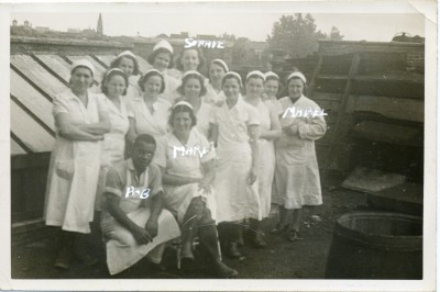 Employees of Wolf Salganik & Sons, a wholesale butcher shop, pose on a rooftop, circa 1935. As in the photo above, we're fortunate in that someone has noted a few names on the photo itself, including Mabel, Mary, Sophie, and – the sole gentleman in the photo, and also the only African American – Bob. It would certainly be convenient if the original note-taker had also jotted down these folks' last names and job titles, but historians know that a little clue is better than none. Gift of Mr. and Mrs. Gordon Salganik. JMM 2004.27.7
