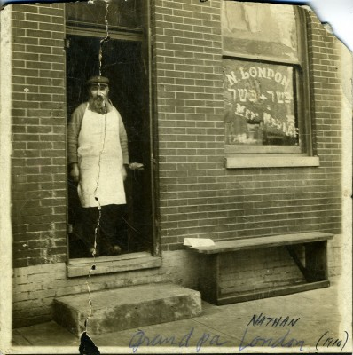 Nathan London in the doorway of his kosher butcher shop on Lombard Street, early 20th century. JMM 2001.90.1