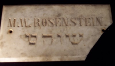 "Marble plaque from the shop of M. W. Rosenstein, c. 1900. Reads ""Shochet"" in Hebrew. Gift of B'nai Israel Congregation, JMM 1993.148.1"