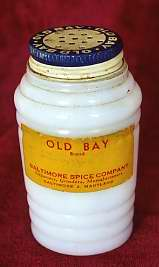 White glass bottle of Old Bay brand Beef Flavor, c. 1950-1955. JMM 1993.59.130
