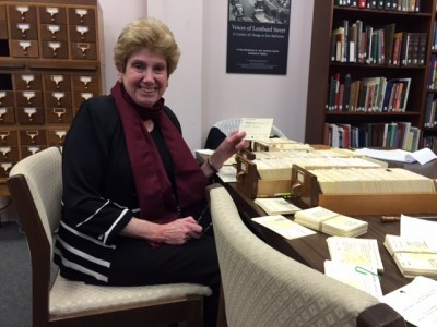 Volunteer Judy hard at work reorganizing and sprucing up our library.