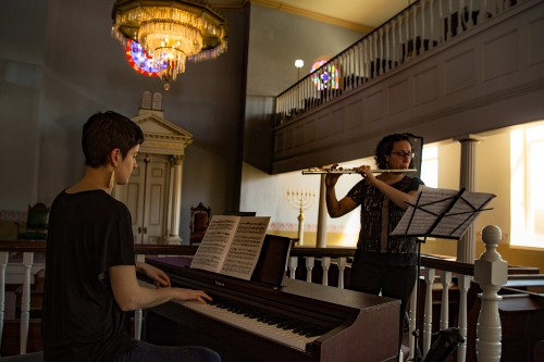 The Occasional Symphony opened the program with a short performance in the Lloyd Street Synagogue.
