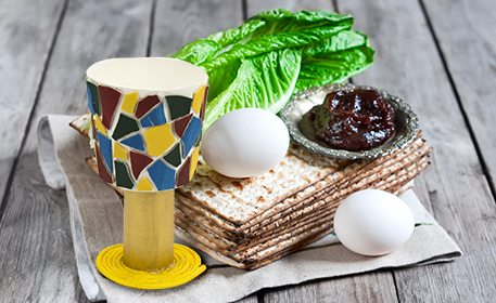 paper cup with matzah, eggs, lettuce, and jam