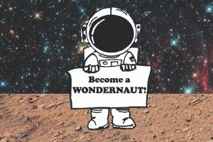 """An illustration of a small astronaut, holding a sign that says """"Become a Wondernaut!"""" The astronaut stands on a photo of dirt with stars in the background."""
