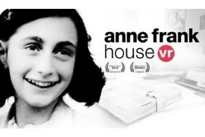 """A black and white photo of Anne Frank, a young woman with dark hair smiling. There is a faded background image of a desk with a close diary book. The words """"Anne Frank House VR"""" in black on top of the background image."""