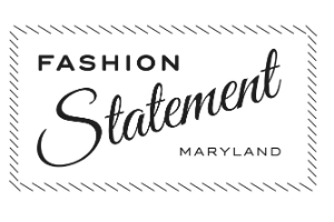 """A white rectangle with the words """"Fashion Statement Maryland"""" in black on it. There are decorative lines resembling sewing stitches around the words."""
