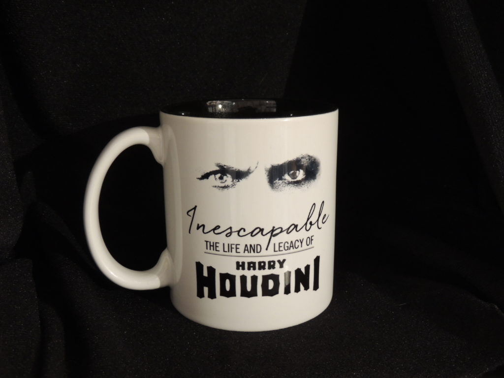 Harry Houdini mug features the steely gaze of the master magician himself. The black-eyed gaze pops against the white ceramic.