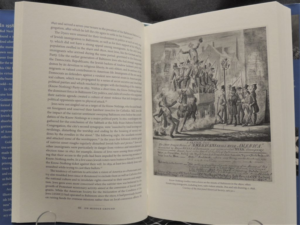 Image shows the interior spread of a book with text on one side and a small line illustration on the other. This particular book is from one of many for sale in the museum shop.