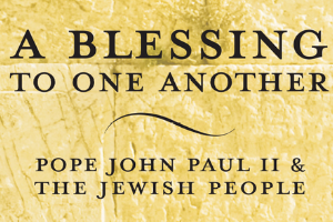 """A yellow, textured rectangle with the words """"A Blessing to One Another: Pope John Paul II & The Jewish People"""" in black on it."""