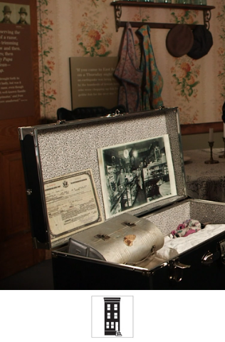 A traveling trunk filled with pictures, objects, and documents, pictured in our Voices of Lombard Street exhibit.