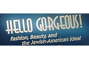 """A blue rectangle with the words """"Hello Gorgeous! Fashion, Beauty, and the Jewish-American Ideal"""" written in white on top."""