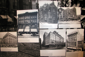Black and white pictures of old Baltimore department buildings, which all had multiple stories, spread out on a panel.