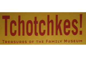 """A yellow rectangle block with the words """"Thotchkes! Treasures of the Family Museum"""" in red text on it."""