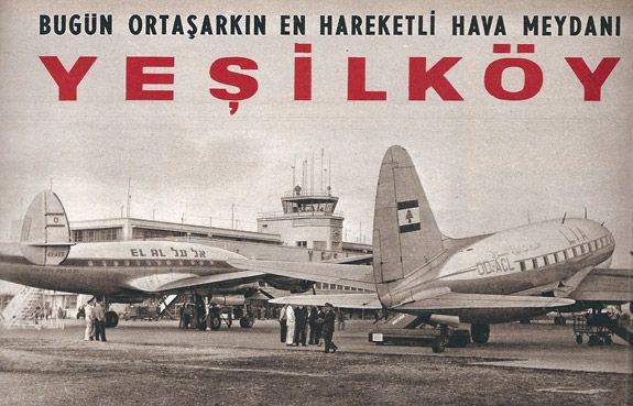 Black and white photo of an older airport terminal with two airplanes in front of it. A number of people are standing around the ground near the planes. The image also has Turkish text on it.