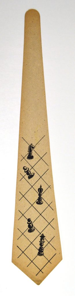One printed tie design: chess pieces on a board]