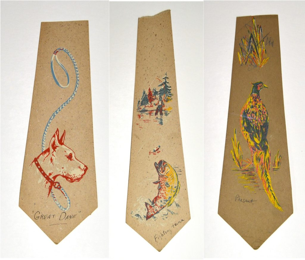 Three printed tie designs: the head of a Great Dane, a flopping fish, and a pheasant.