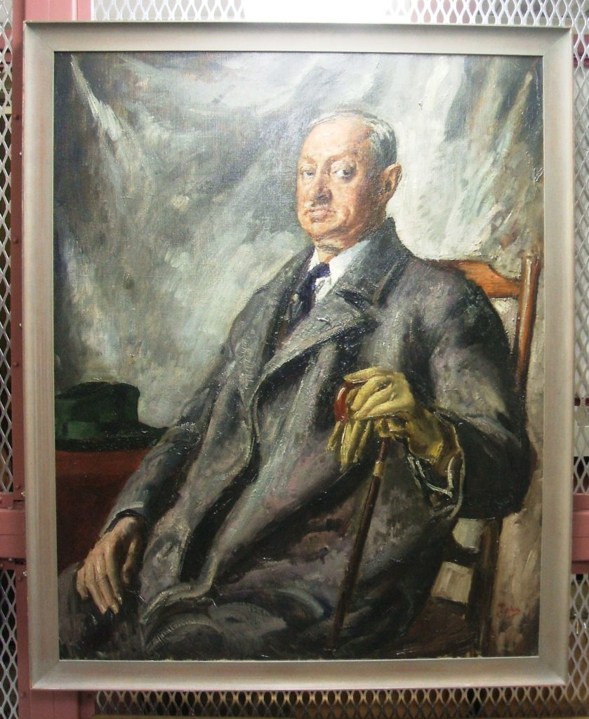 Oil  painting of an older white man seated, wearing an overcoat and holding a cane.