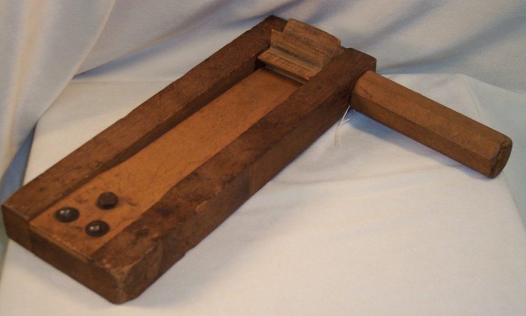 wooden grogger or noisemaker