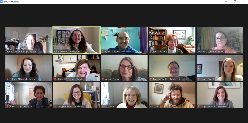 a screenshot of a Zoom call, showing 15 adults smiling from their work-from-home office.