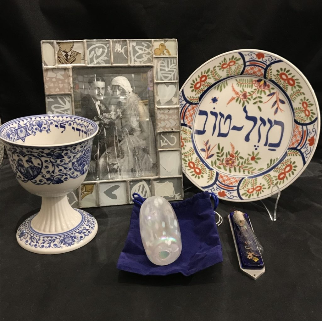 wedding cup, frame, plate, mezuzzah, and glass for breaking.